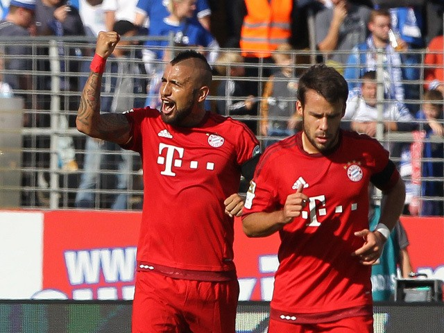 Bayern Munich's Chilean midfielder Arturo Vidal (L) celebrates scoring during the German first division Bundesliga football match SV Darmstadt 98 vs FC Bayern Munich, in Darmstadt, southern Germany on September 19, 2015