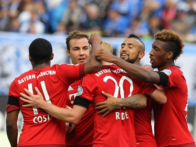 Bayern Munich's midfielder Sebastian Rode (C) is congratulated by teammates after scoring the 3-0 during the German first division Bundesliga football match SV Darmstadt 98 vs FC Bayern Munich in Darmstadt, western Germany on September 19, 2015
