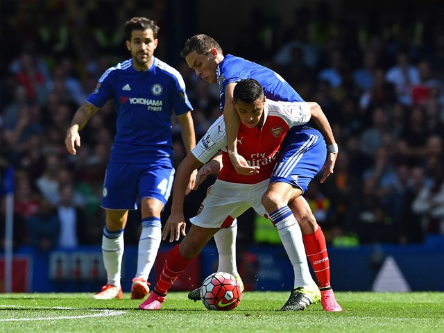 Chelsea's Serbian midfielder Nemanja Matic (R) vies with Arsenal's Chilean striker Alexis Sanchez during the English Premier League football match between Chelsea and Arsenal at Stamford Bridge in London on September 19, 2015