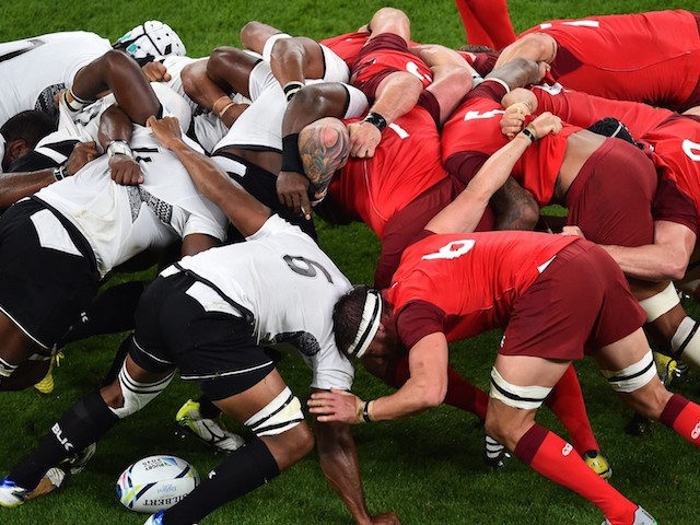 Fiji's and England's players vie in a scrum during a Pool A match of the 2015 Rugby World Cup between England and Fiji at Twickenham stadium in south west London on September 18, 2015.