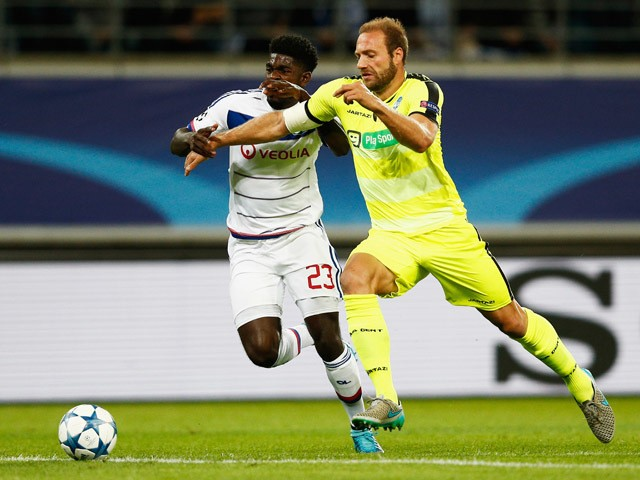 Laurent Depoitre of Gent battles for the ball with Samuel Umtiti of Lyon during the UEFA Champions League Group H match between KAA Gent and Olympique Lyonnais held at Ghelamco Arena on September 16, 2015