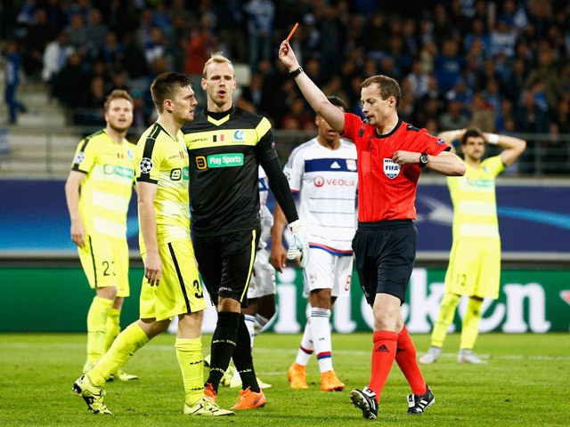 Referee, William Collum shows Thomas Foket of Gent a red card during the UEFA Champions League Group H match between KAA Gent and Olympique Lyonnais held at Ghelamco Arena on September 16, 2015