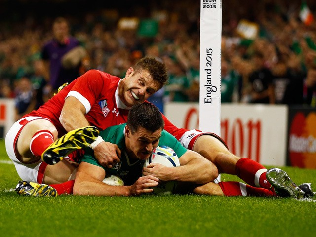 Jonathan Sexton of Ireland scores the third try for his team during the 2015 Rugby World Cup Pool D match between Ireland and Canada at the Millennium Stadium on September 19, 2015