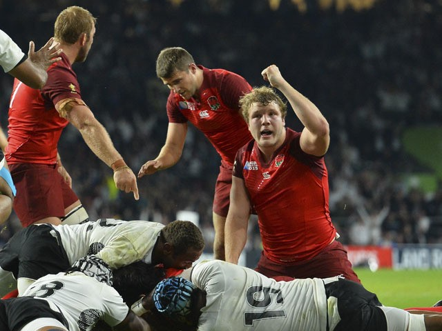 England's lock Joe Launchbury (R) reacts as England's back row Billy Vunipola scores a try during a Pool A match of the 2015 Rugby World Cup between England and Fiji at Twickenham stadium in south west London on September 18, 2015