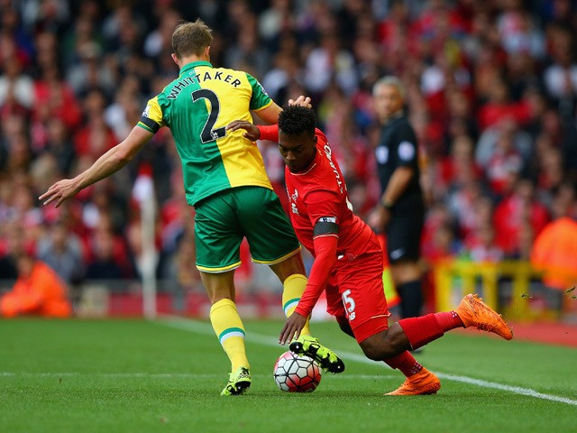 Steven Whittaker of Norwich City and Daniel Sturridge of Liverpool battle for the ball during the Barclays Premier League match between Liverpool and Norwich City at Anfield on September 20, 2015
