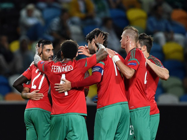 Lokomotiv's midfielder Aleksandr Samedov (L) celebrates with teammates after scoring the opening goal during the UEFA Champions League group H football match Sporting CP vs Lokomotiv Moskva at the Jose Alvalade stadium in Lisbon on September 17, 2015