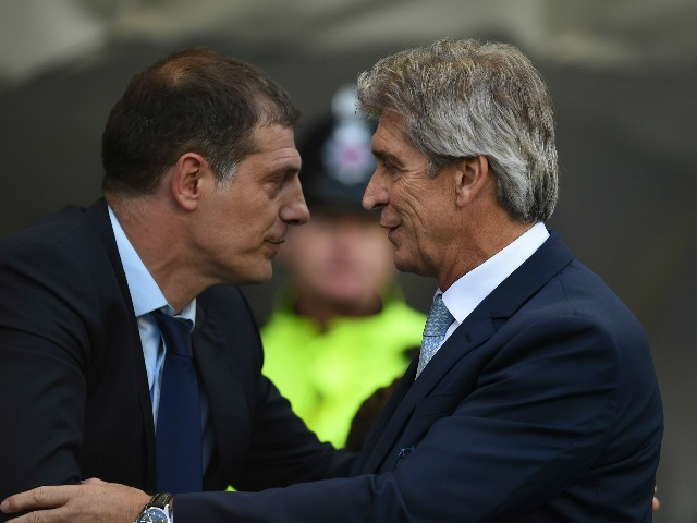 West Ham United's Croatian manager Slaven Bilic (L) greets Manchester City's Chilean manager Manuel Pellegrini (R) before the English Premier League football match between Manchester City and West Ham United at The Etihad Stadium in Manchester, north west