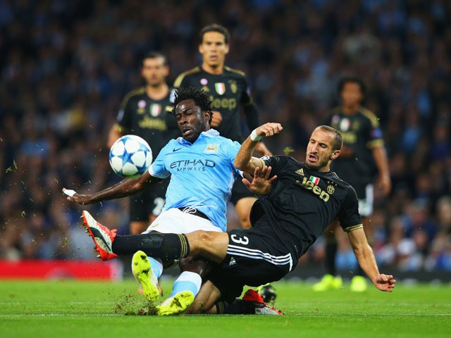 Wilfred Bony of Manchester City is tackled by Giorgio Chiellini of Juventus during the UEFA Champions League Group D match between Manchester City FC and Juventus at the Etihad Stadium on September 15, 2015