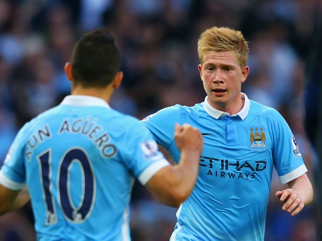 Kevin de Bruyne of Manchester City celebrates scoring his team's first goal with his team mate Sergio Aguero during the Barclays Premier League match between Manchester City and West Ham United at Etihad Stadium on September 19, 2015