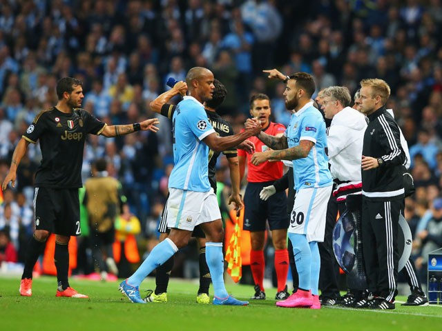 An injured Vincent Kompany of Manchester City is substituted for Nicolas Otamendi of Manchester City during the UEFA Champions League Group D match between Manchester City FC and Juventus at the Etihad Stadium on September 15, 2015