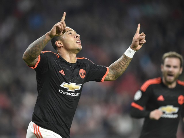 Manchester's Dutch forward Memphis Depay celebrates after scoring the opening goal during the UEFA Champions League Group B football match between PSV Eindhoven and Manchester United at the Philips stadium in Eindhoven, the Netherlands, on September 15, 2
