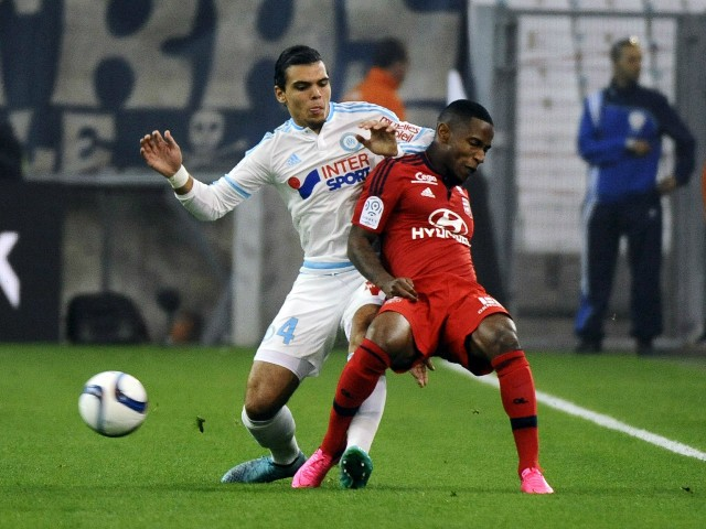 Marseille's Dutch defender Karim Rekik (L) vies with Lyon's French forward Claudio Beauvue during the French L1 football match Marseille (OM) vs Lyon (OL) on September 20, 2015 at Velodrome Stadium in Marseille, southern France.