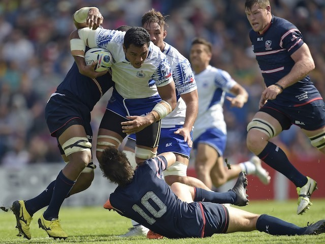 Samoa flanker Maurie Fa'asavalu is tackled during the Rugby World Cup game with the USA on September 20, 2015