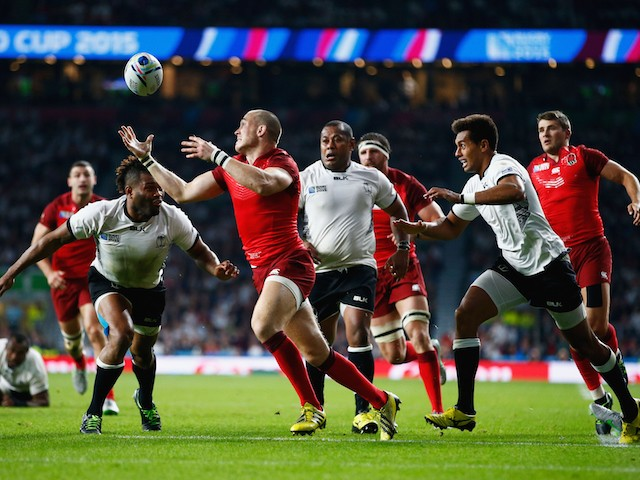 Mike Brown of England breaks through to score their third try during the 2015 Rugby World Cup Pool A match between England and Fiji at Twickenham Stadium on September 18, 2015 in London, United Kingdom