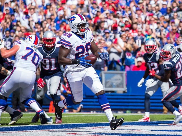 Karlos Williams #29 of the Buffalo Bills runs in a touchdown on the first drive against the New England Patriots to on September 20, 2015 at Ralph Wilson Stadium in Orchard Park, New York.