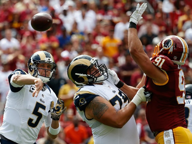Quarterback Nick Foles #5 of the St. Louis Rams throws a first half pass against the Washington Redskins at FedExField on September 20, 2015 in Washington, DC.