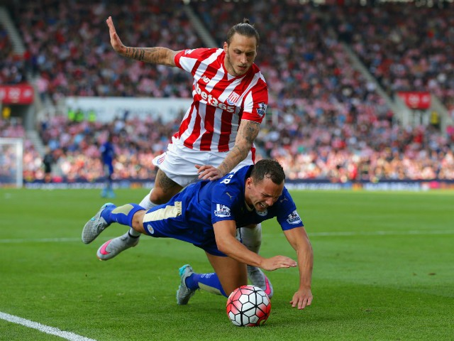 Danny Drinkwater of Leicester City is fouled by Marko Arnautovic of Stoke City in the penalty area during the Barclays Premier League match between Stoke City and Leicester City at Britannia Stadium on September 19, 2015 in Stoke on Trent, United Kingdom.