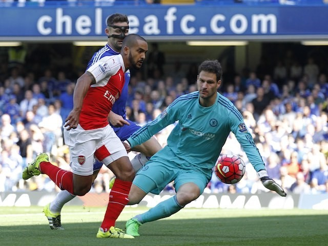 Arsenal's Theo Walcott tries to slip one past Chelsea keeper Asmir Begovic on September 19, 2015