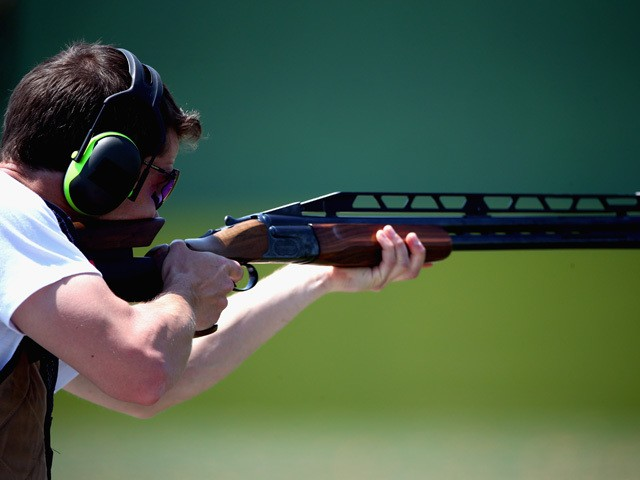 Tim Kneale of Great Britain shoots in the Men's Double Trap Shooting qualificationduring day seven of the Baku 2015 European Games at the Baku Shooting Centre on June 19, 2015