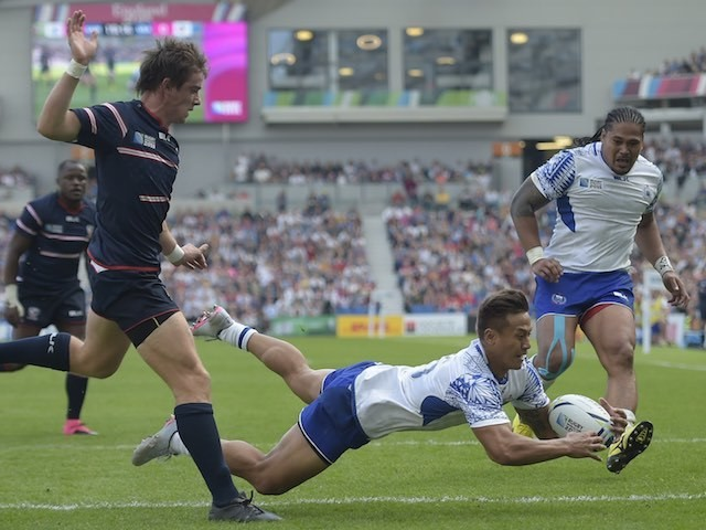 Samoa's Tim Nanai-Williams scores a try during the Rugby World Cup game with the USA on September 20, 2015