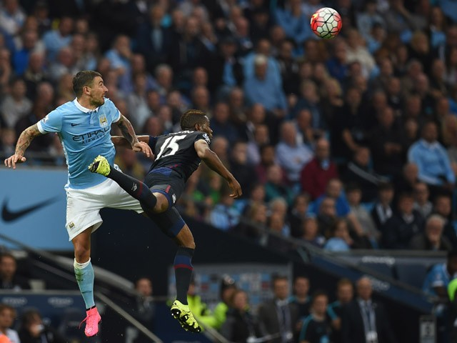 West Ham United's Senegalese striker Diafra Sakho (R) vies with Manchester City's Serbian defender Aleksandar Kolarov (L) during the English Premier League football match between Manchester City and West Ham United at The Etihad Stadium in Manchester, nor
