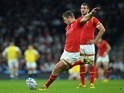Dan Biggar kicks a penalty for Wales during the Rugby World Cup game with England on September 26, 2015