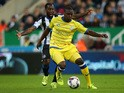 Vurnon Anita of Newcastle United vies with Jeremy Helan of Sheffield Wednesday during the Capital One Cup Third Round match between Newcastle United and Sheffield Wednesday at St James Park on September 23, 2015
