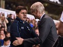 Arsenal's French manager Arsene Wenger greets Tottenham Hotspur's Argentinian Head Coach Mauricio Pochettino (L) ahead of the English League Cup third round football match between Tottenham Hotspur and Arsenal at White Hart Lane in north London on Septemb