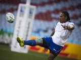 Samoa's wing Alesana Tuilagi kicks the ball during the captain's run training session at Villa park stadium in Birmingham on September 25, 2015