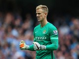 Joe Hart of Manchester City celebrates his team's third goal during the Barclays Premier League match between Manchester City and Chelsea at the Etihad Stadium on August 16, 2015