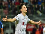 Fiorentina's Croatian forward Nikola Kalinic celebrates after scoring a goal during the Serie A football match between Inter Milan and Fiorentina at the San Siro Stadium in Milan on September 27, 2015