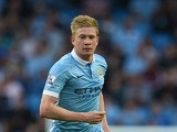 Manchester City's Belgian midfielder Kevin De Bruyne runs with the ball during the English Premier League football match between Manchester C