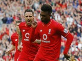 Liverpool's English striker Daniel Sturridge (R) celebrates after scoring his team's third goal during the English Premier League football match between Liverpool and Aston Villa at the Anfield stadium in Liverpool, north-west England on September 26, 201