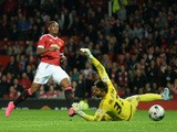 Anthony Martial of Manchester United scores his team's third goal past Bartosz Bialkowski of Ipswich Town during the Capital One Cup Third Round match between Manchester United and Ipswich Town at Old Trafford on September 23, 2015
