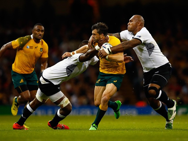 Adam Ashley-Cooper of Australia is tackled by Leone Nakarawa (L) and Nemani Nadolo of Fiji during the 2015 Rugby World Cup Pool A match between Australia and Fiji at the Millennium Stadium on September 23, 2015
