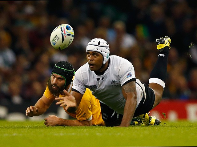 Akapusi Qera of Fiji dives to gather the ball during the 2015 Rugby World Cup Pool A match between Australia and Fiji at the Millennium Stadium on September 23, 2015