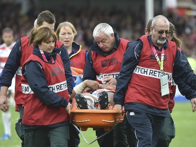 Japan's Amanaki Mafi is stretchered off during the Rugby World Cup game with Scotland on September 23, 2015