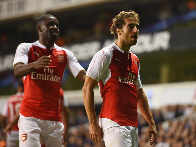 Mathieu Flamini of Arsenal celebrates with Joel Campbell as he scores their first goal during the Capital One Cup third round match between Tottenham Hotspur and Arsenal at White Hart Lane on September 23, 2015