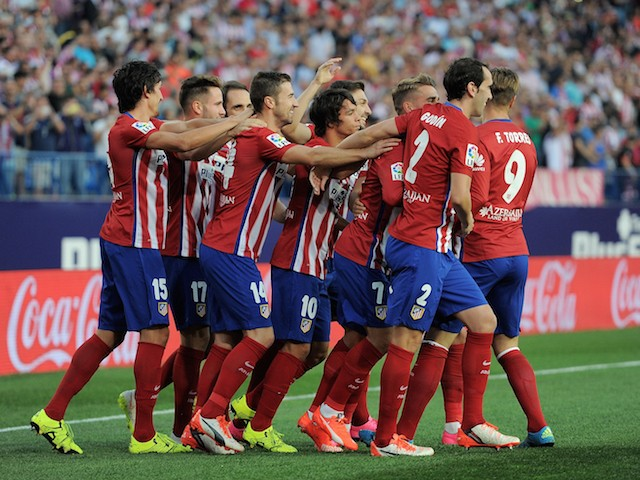 Club Atletico de Madrid players celebrate after scoring their opening goal during the La Liga match between Atletico de Madrid and Getafe at Vicente Calderon Stadium on September 22, 2015 in Madrid, Spain.