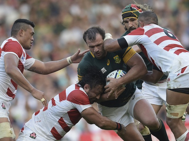 South Africa's hooker Bismarck du Plessis (C) is takcled during a Pool B match of the 2015 Rugby World Cup between South Africa and Japan at the Brighton community stadium in Brighton, south east England on September 19, 2015.