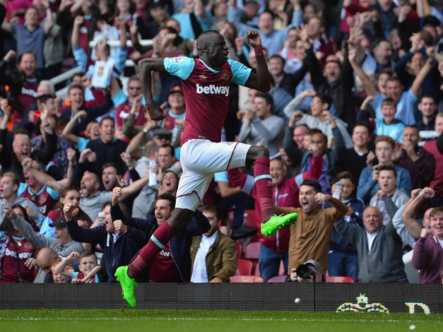 Cheikhou Kouyate of West Ham United celebrates scoring his team's second goal during the Barclays Premier League match between West Ham United and Norwich City at the Boleyn Ground on September 26, 2015