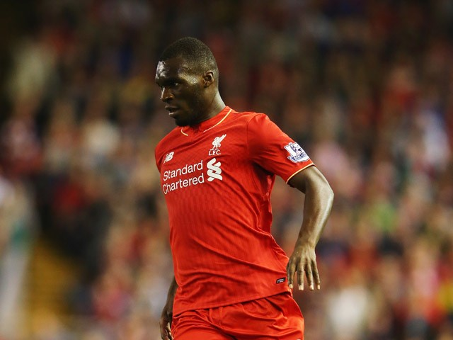 Christian Benteke of Liverpool runs with the ball during the Barclays Premier League match between Liverpool and A.F.C. Bournemouth at Anfield on August 17, 2015