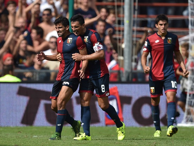 Tomas Rincon (L) and Nicolas Burdisso of Genoa CFC celebrate victory at the end of the Serie A match between Genoa CFC and AC Milan at Stadio Luigi Ferraris on September 27, 2015