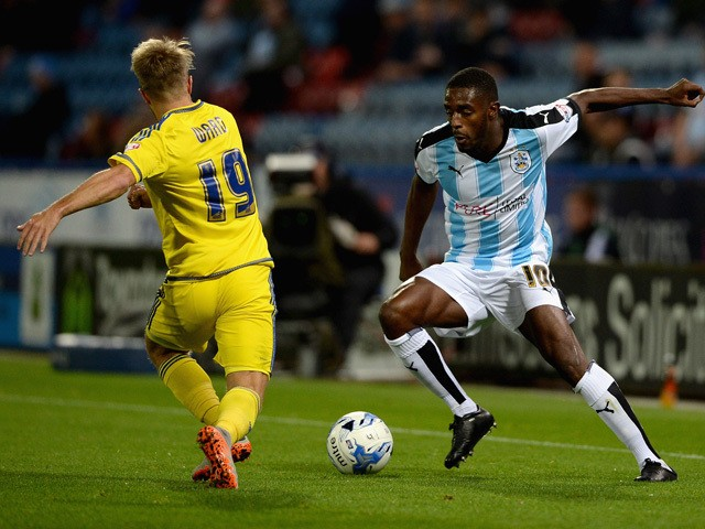 Mustapha Carayol of Huddersfield Town looks to get past Jamie Ward of Nottingham Forest during the Sky Bet Championship match between Huddersfield Town and Nottingham Forest at John Smiths Stadium on September 24, 2015