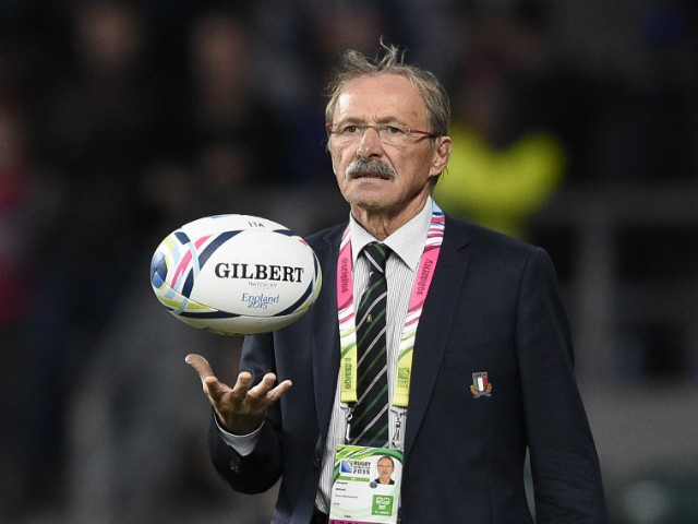 Italy's head coach Jacques Brunel inspects the pitch before a Pool D match of the 2015 Rugby World Cup between France and Italy at Twickenham stadium, south west London on September 19, 2015.