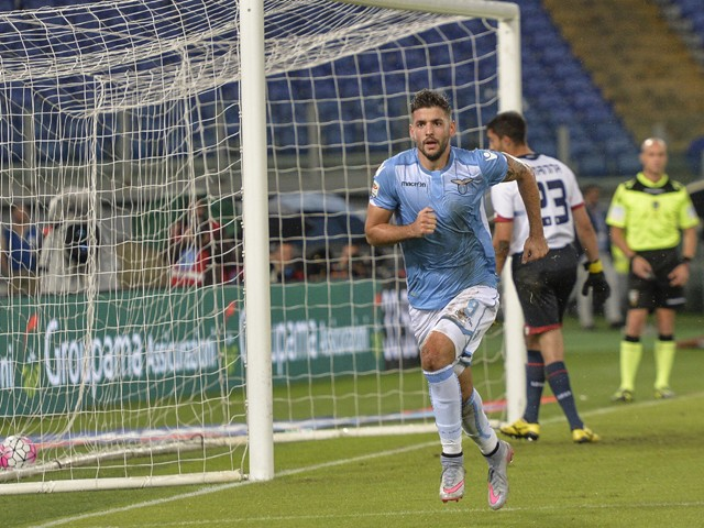 Lazio's forward from Serbia Filip Djordjevic celebrates after scoring a goal during the Italian Serie A football match Lazio vs Genoa on September 23, 201