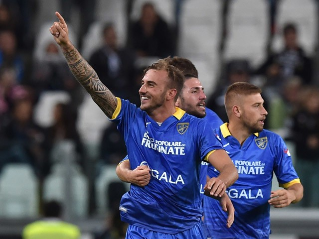 Leonardo Blanchard (L) of Frosinone Calcio celebrates his goal with team mates during the Serie A match between Juventus FC and Frosinone Calcio at Juventus Arena on September 23, 2015