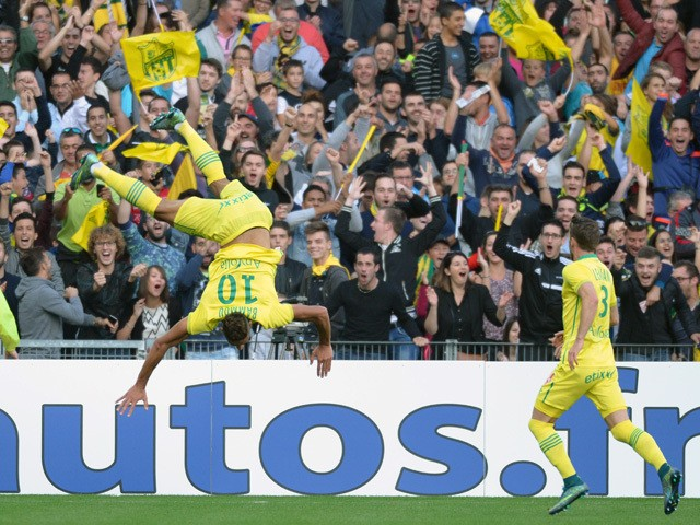 Nantes' French forward Yacine Bammou (L) celebrates after scoring a goal during the French L1 football match between Nantes (FCN) and Paris Saint-Germain (PSG) on September 26, 2015