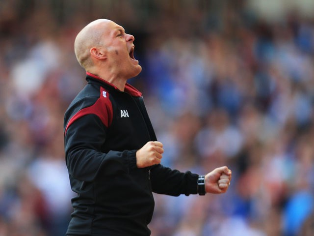 Alex Neil Manager of Norwich City celebrates his team's first goal by Robbie Brady (not pictured) during the Barclays Premier League match between West Ham United and Norwich City at the Boleyn Ground on September 26, 2015