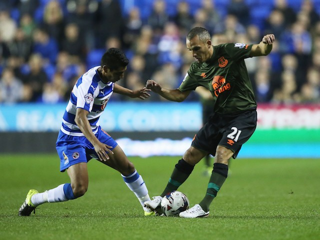 Paolo Hurtado of Reading and Leon Osman of Everton compete for the ball during the Capital One Cup third round match between Reading and Everton at Madejski Stadium on September 22, 2015 in Reading, England.